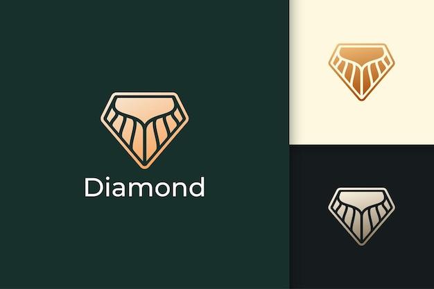 O logotipo de diamante ou gema em luxo e elegante representa joias ou cristal