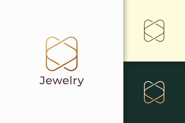 O logotipo de joia de ouro de luxo em forma de linha representa expansivo e precioso