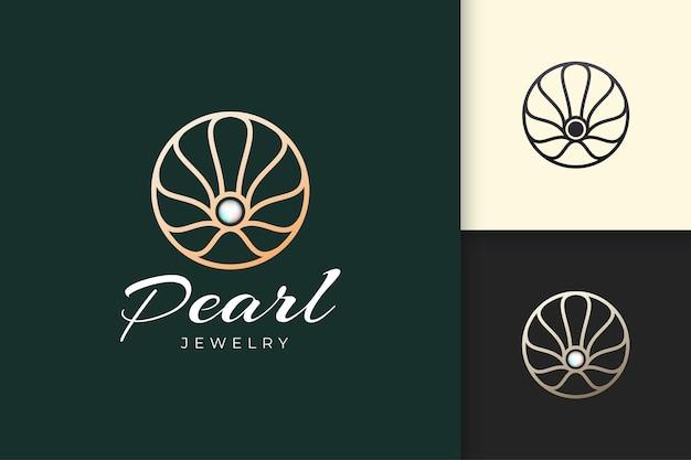O logotipo de pérola de luxo em forma abstrata e circular representa joias ou beleza