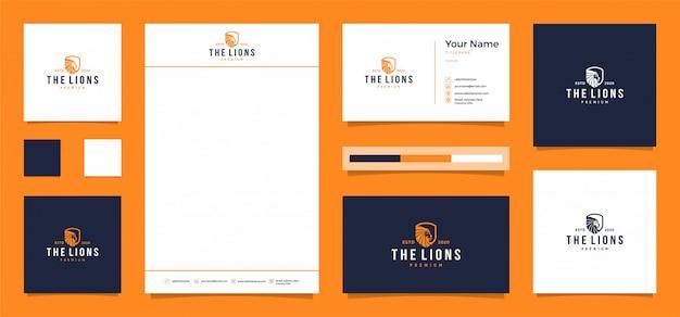O logotipo do leão com um cartão de visita grátis e papel timbrado Vetor Premium