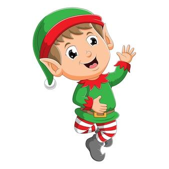 O menino elfo feliz com o chapéu de papai noel está acenando com a mão da ilustração