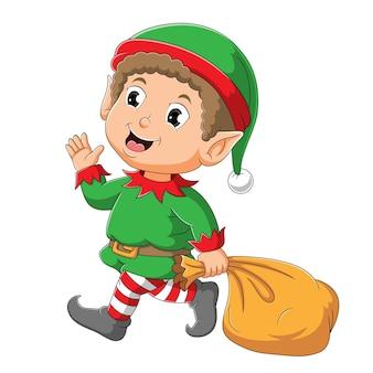 O menino elfo fofo acenando e segurando o saco da ilustração