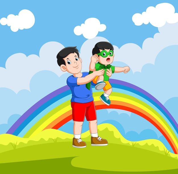 O menino está usando a fantasia de super-herói e brincando com seu pai