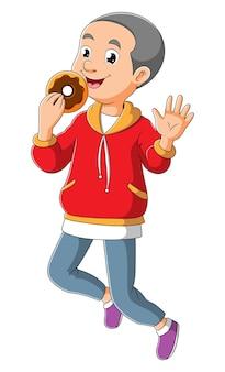 O menino feliz está comendo o donut da ilustração