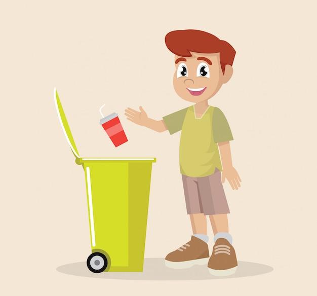 O menino pôs o desperdício plástico em recicl o escaninho de lixo.