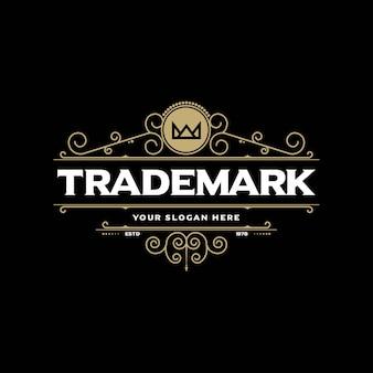O modelo de logotipo de luxo floresce a identidade de linhas caligráficas de ornamento elegante.