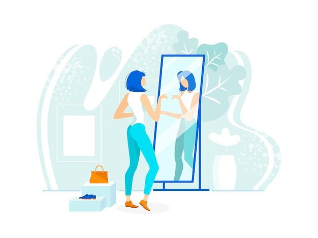 O olhar à moda da verificação geral da jovem mulher reflete o espelho.