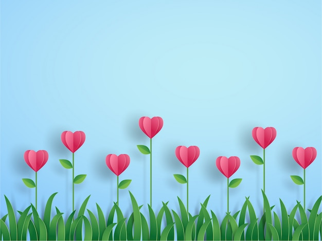 O origâmi cor-de-rosa floresce na forma do coração e grama no azul no conceito do cartão do valentim. projeto de arte ilustração vetorial em papel cortado estilo.