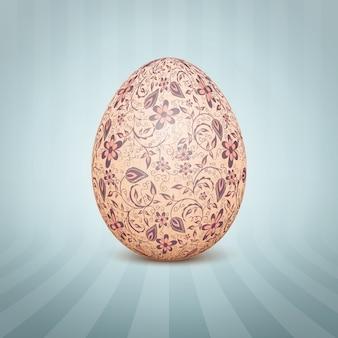 O ovo de páscoa com um ornamento padrão floral