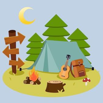 O pacote de acampamento para ir para a viagem de piquenique na floresta
