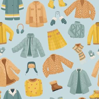 O padrão sem emenda com roupas de inverno. casacos, o conjunto de vetores de roupas de inverno. casacos, chapéus, luvas, sapatos e meias.