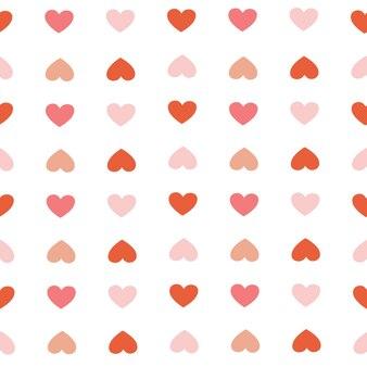 O padrão sem emenda de coração vermelho e coração rosa