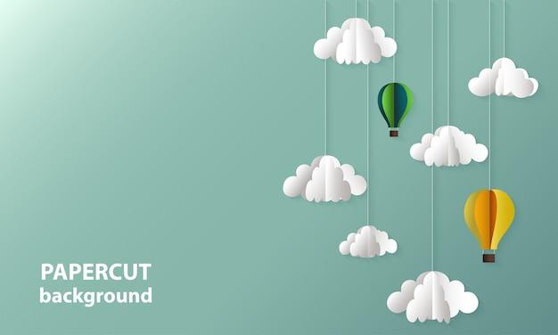 O papel de fundo cortou formas das nuvens e dos balões.
