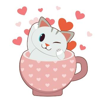 O personagem de gato bonito sentado no copo rosa com o coração.