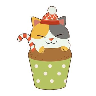 O personagem de gato bonito veste um grande cupcake no tema de natal. o cupcake de chocolate tem um doce.