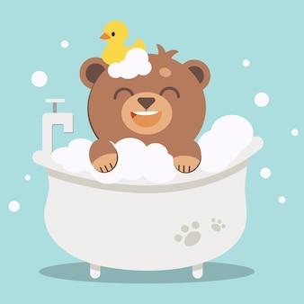 O personagem do urso bonito na banheira com borracha de pato.