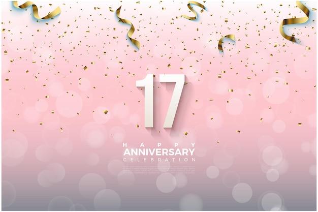 O plano de fundo do 17º aniversário com números dourados caindo e fitas