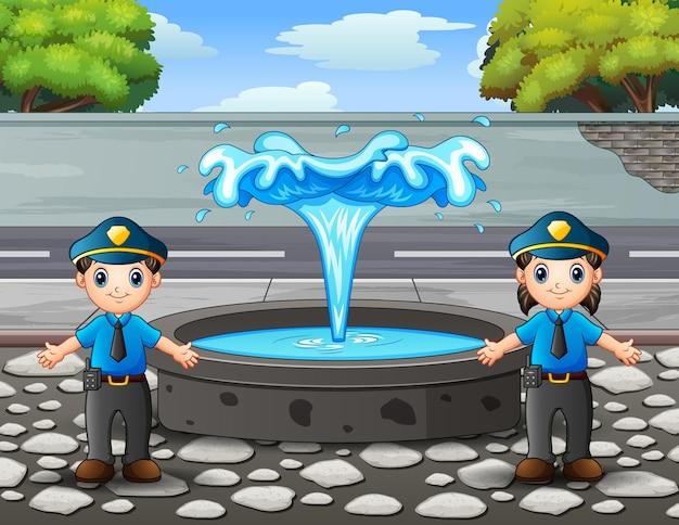 O policial parado perto da fonte