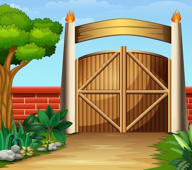 O portão de madeira em uma bela natureza