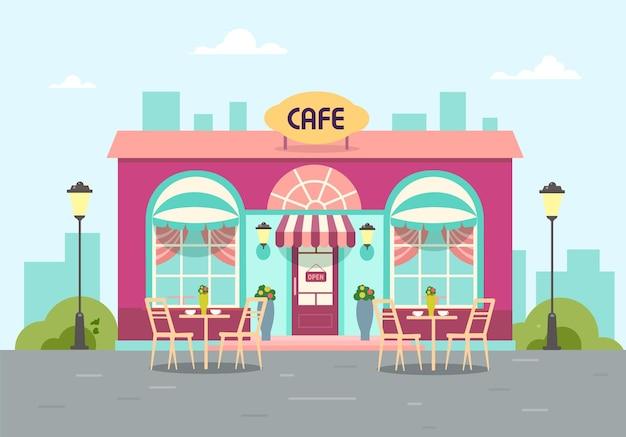 O prédio é um café de verão. café estiloso na cidade com uma mesa