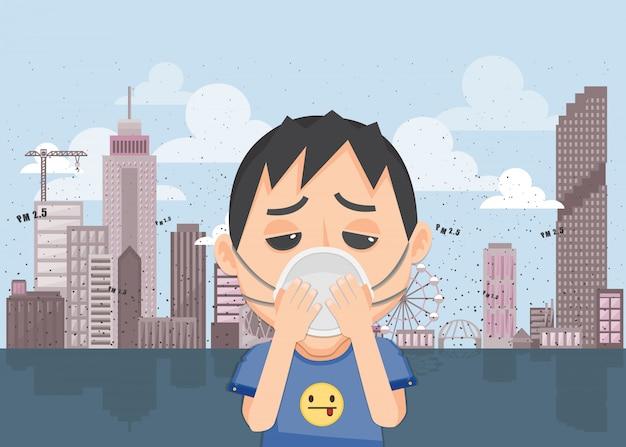 O rapaz está usando uma máscara n95 para proteger a poluição do ar ao ar livre. pm 2,5 no medidor de pó