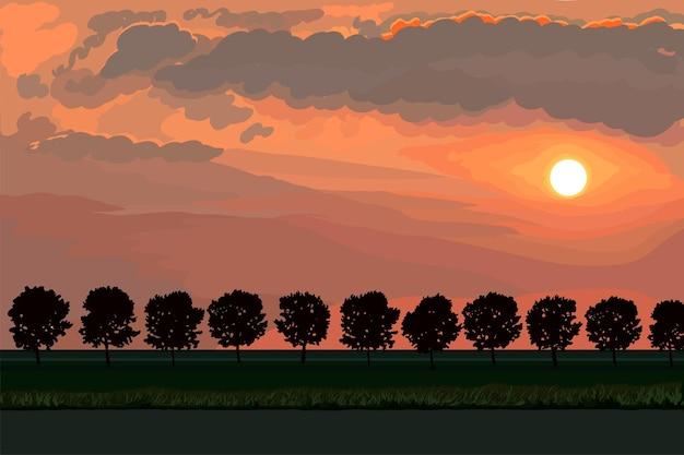 O sol poente ilumina uma fileira de árvores à beira da estrada