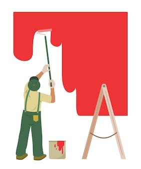 O trabalhador pinta a parede para renovação.