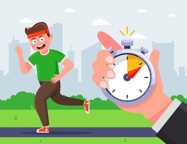 O treinador marca o tempo em que o atleta masculino correu.