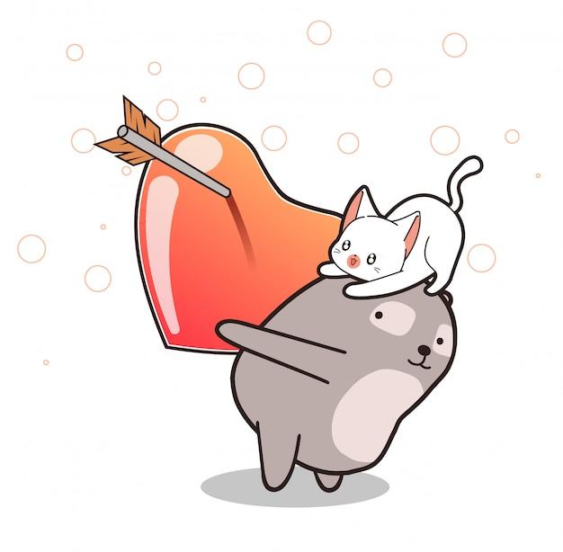 O urso adorável está levantando o gato e o coração