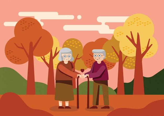 O velho casal desfrutar no parque durante o outono