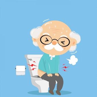 O velho estava defecando no banheiro com dificuldade e sério como má saúde.
