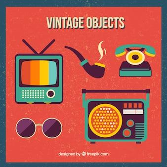 Objetos do vintage ajustados no projeto plana