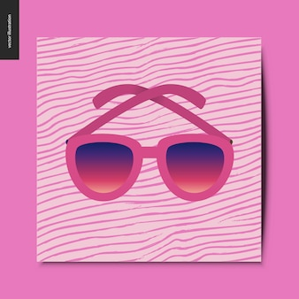 Óculos de sol no cartão rosa
