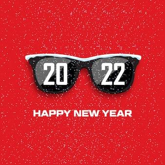 Óculos pretos hipster sobre fundo de neve 2022 feliz ano novo e feliz natal
