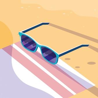 Óculos, toalha, praia