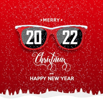 Óculos vermelhos hippie sobre fundo de neve 2022 paisagem de feliz ano novo e feliz natal