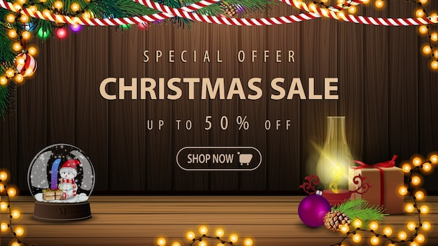 Oferta especial, venda de natal, descontos de até 50%, banner de desconto bonito com decoração de natal. cartão postal com um interior acolhedor