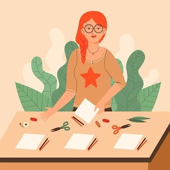 Oficina criativa diy com mulher e artigos de papelaria