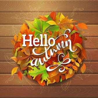 Olá, fundo de outono. folhas de outono coloridas brilhantes em fundo de madeira