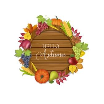 Olá tábua de madeira de outono com frutas e folhas