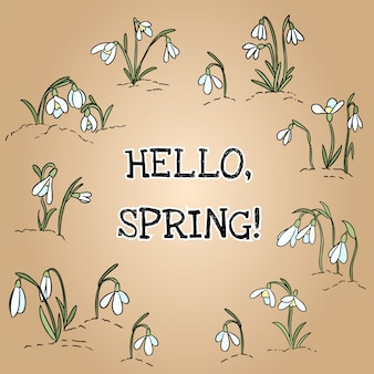 Olá texto de primavera na grinalda do ornamento snowdrops.