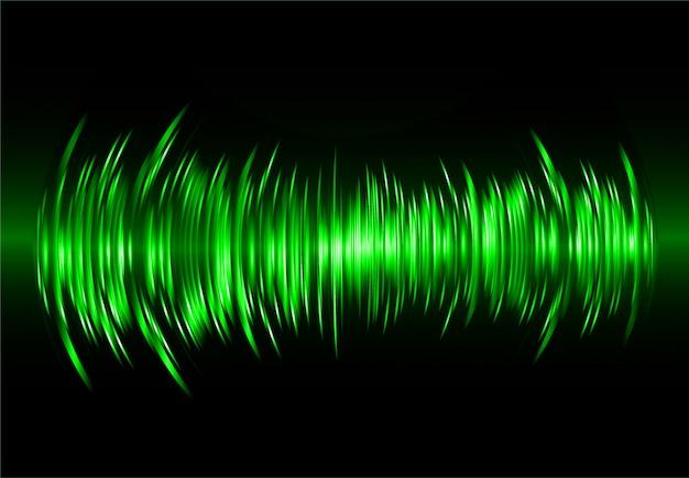Ondas sonoras oscilando em luz verde escura