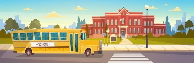 Ônibus amarelo na frente do prédio da escola de transporte de alunos