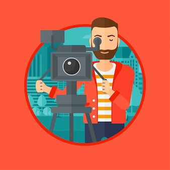 Operador de câmara com a câmera de filme no tripé.