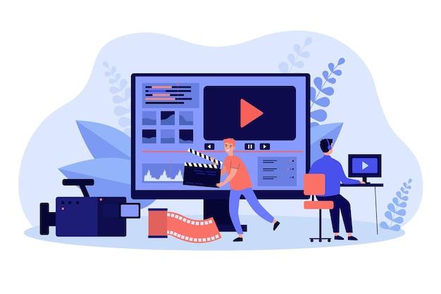 Operadores de vídeo minúsculos trabalhando com conteúdo de mídia visual