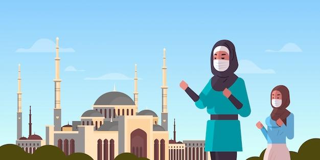 Orações de mulheres árabes em máscaras ramadan kareem mês sagrado coronavírus pandemia quarentena conceito