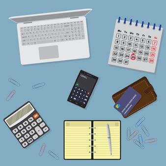 Organzation da tabela do escritório com estacionário, portátil, caderno, cale