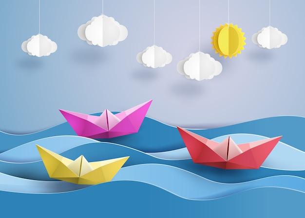 Origami fez barco a vela de papel colorido