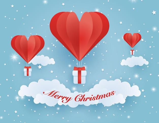 Origami fez um balão de ar quente voando no céu com o coração flutuando no céu ilustração de amor