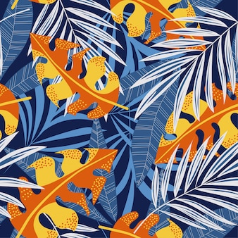 Original abstrato padrão sem emenda com folhas tropicais coloridas e plantas em fundo azul